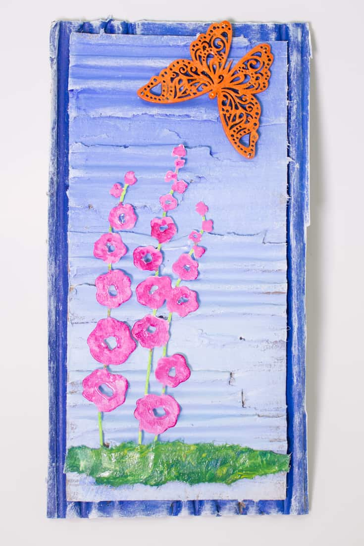Here's your challenge:  create a minimalistic mixed media art project out of paper and cardboard using only 6 elements.