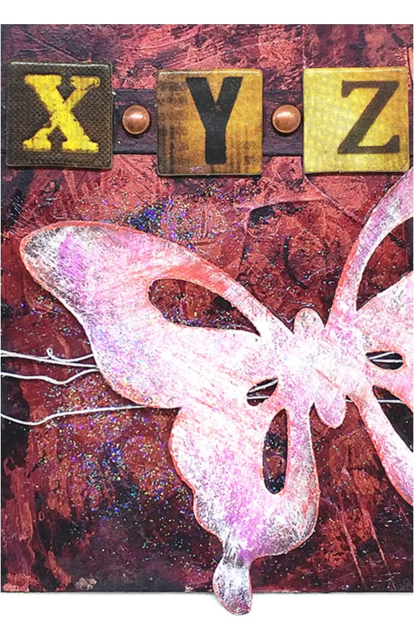Combining a few different elements for this mixed media piece with a butterfly, wire and chipboard letters.